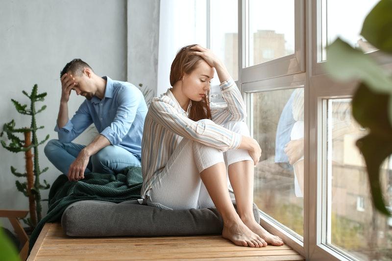 Sad couple after quarrel at home