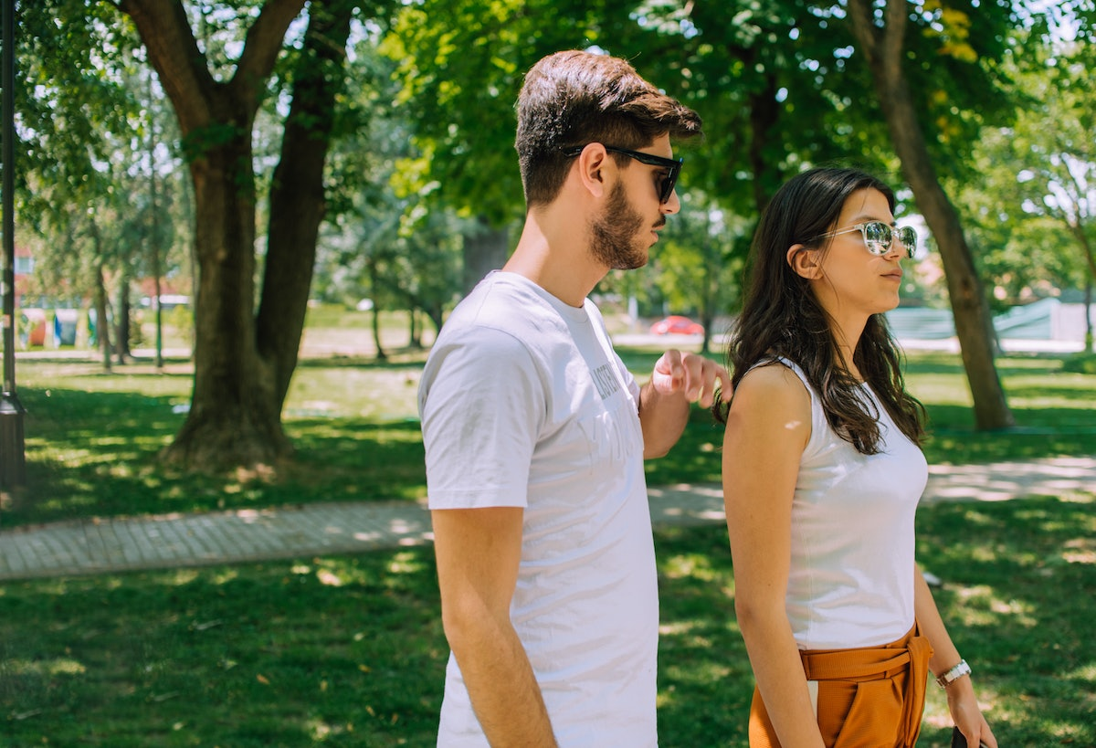 Full length portrait of happy couple, young man and woman on romantic date in nature