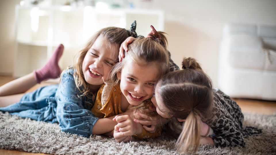 The greatest love is for the sister. Three little girls at home.