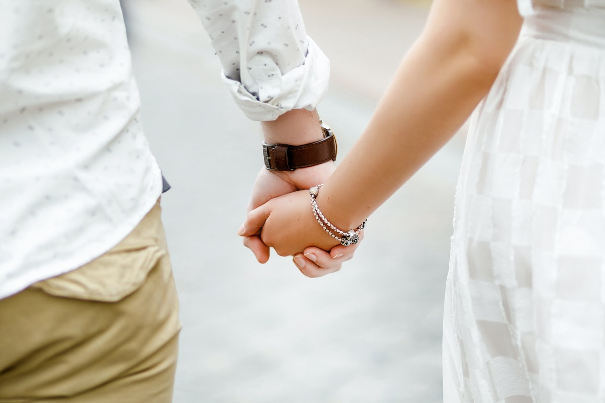 Hands of lovers on a walk