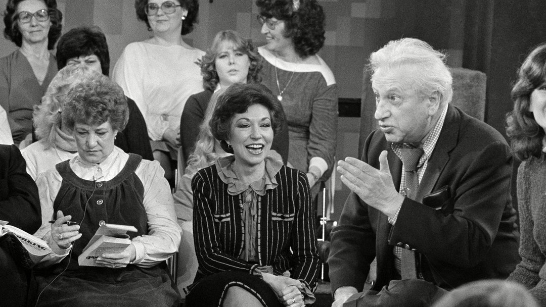 "Author Studs Terkel makes a point during taping of the Phil Donahue TV show in Chicago. Terkel's book, ""Working"", stirred a controversy in Girard, Pa. when parents objected to its use its high school classes. Left is Girard school board president Alice Fulgenzio, who said she was opposed to removing the book from classes"