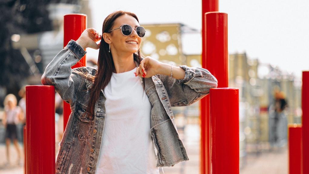 Portrait of a happy woman walking in park