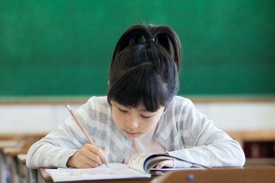 Girl studying in a classroom
