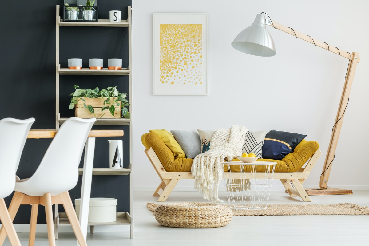 Small hand-made stylish table with bowl of lemons