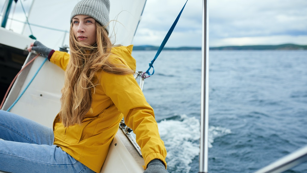 Young woman sailing the boat