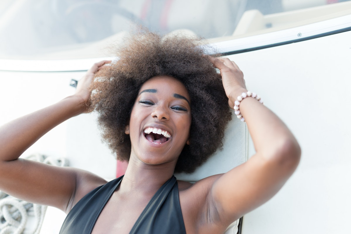 Attractive afro american girl on a yacht at summer day