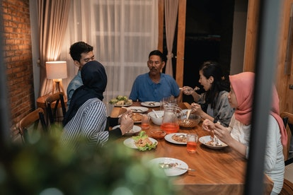asian muslim family dinner together at home. break fasting concept