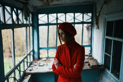 woman alone in an abandoned house