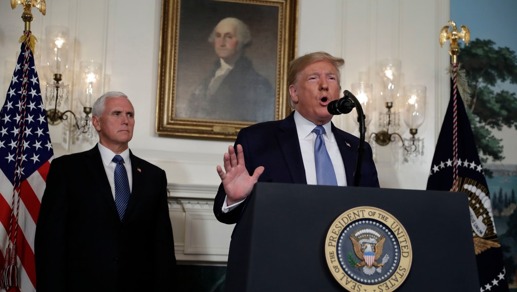 President Donald Trump speaks about the mass shootings in El Paso, Texas and Dayton, Ohio, in the Diplomatic Reception Room of the White House, in Washington. Vice President Mike Pence is left