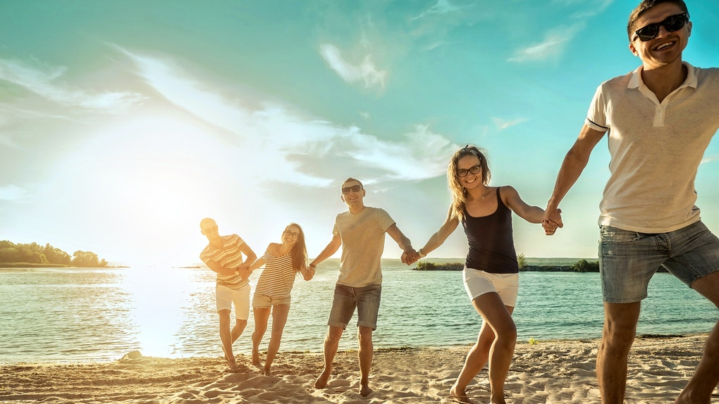 Happiness Friends fun on the beach under sunset sunlight in summer sunny day. Friendship concept.