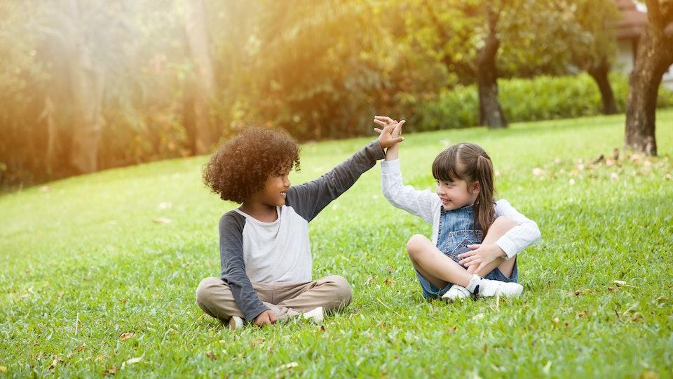Children playing in the garden in summer day