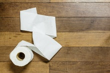 Toilet paper on wood background
