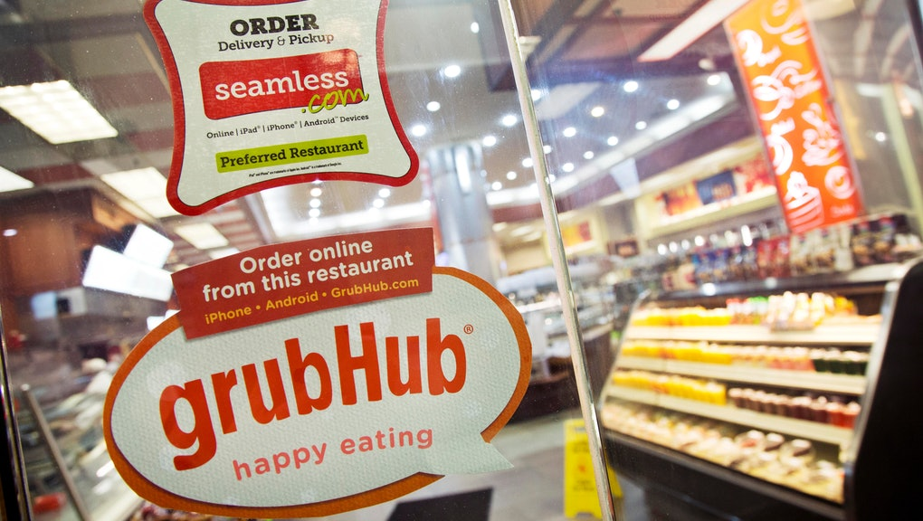 GrubHub, Seamless Signs for GrubHub and Seamless are displayed on the door to a New York restaurant, . Shares in GrubHub will begin trading at the New York Stock Exchange Friday. GrubHub, based in Chicago, also owns the Seamless food ordering website. The company connects nearly 29,000 restaurants with users in more than 600 U.S. cities. More than 3 million people have placed an order through GrubHub websites in the past year