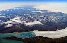 An aerial view shows the wild landscape, ice flows and glaciers of Greenland, seen through an airpla...