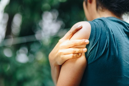 Woman with pain in shoulder and upper arm ,Ache in human body , office syndrome , health care concept