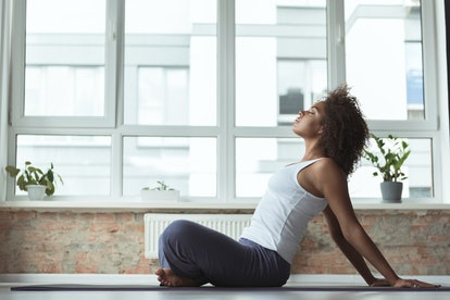 Calm woman practicing sport in apartment