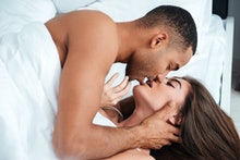 Sexy passionate young couple having sex in bed at home
