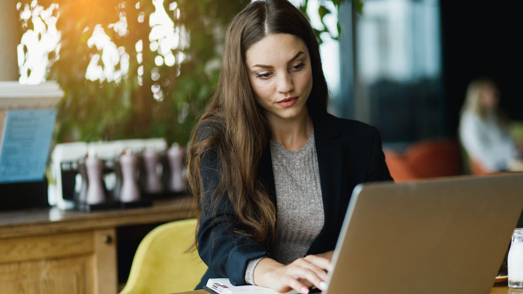 Girl with laptop seriously working