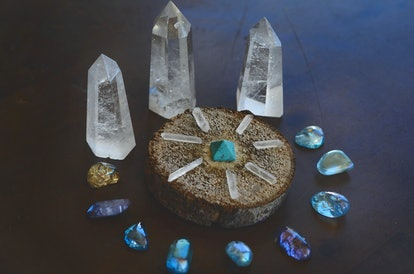 Beautiful, sparkling healing crystals. Witchy crystal grid, wiccan alter set up. Healing energy, shot in natural lighting with low exposure. Crystal Grid, sacred space. Bohemian decorations, romantic
