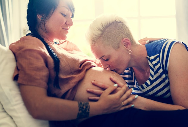 A pregnant lesbian woman and her partner.