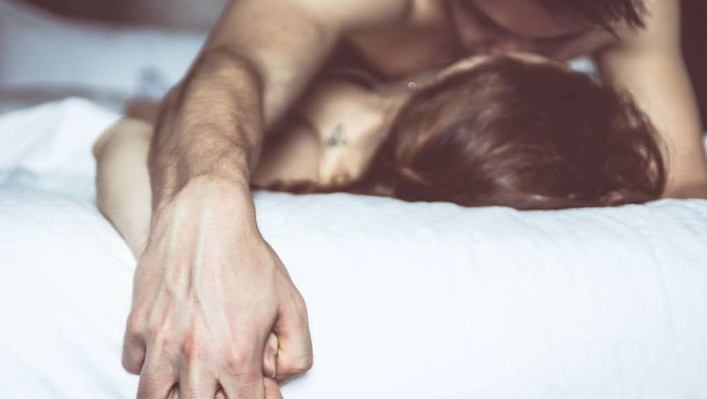 Couple in love having sex on the bed at honeymoon. Concept about love, sex and lifesyle