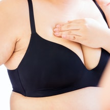 plus size asian woman doing the breast cancer self check