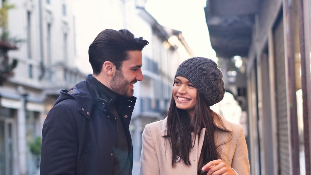 A couple of young engaged or friends, while they are shopping, having fun together. Concept of: shopping, entertainment, friendship, love and leisure.