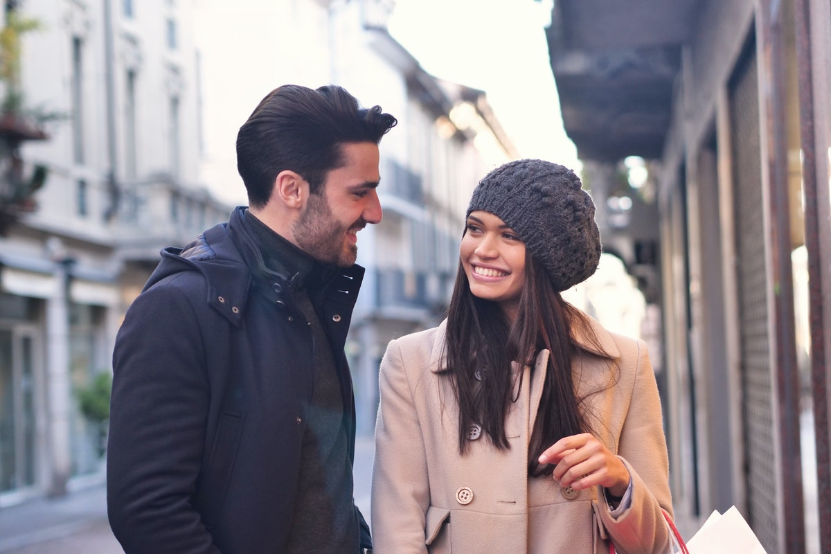 A couple of young engaged or friends, while they are shopping, having fun together. Concept of: shop...