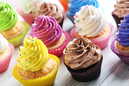 Tasty cupcakes on a white wooden table