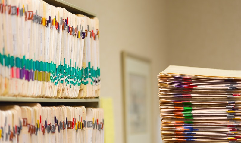 Medical Records folder archive organized in the file cabinet all in a row