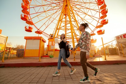 boy and girl in the park at the ferris wheel