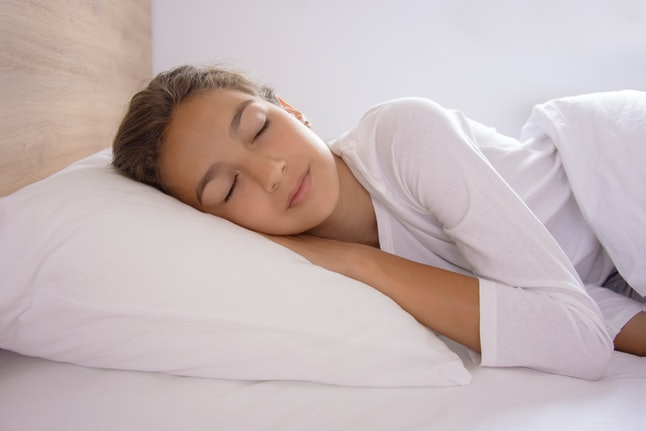 Young woman sleeping in the bed