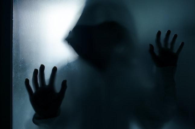 halloween concept, blur of murderer in house