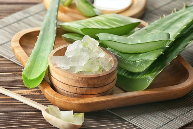 Bowl with aloe vera on wooden tray. Aloe vera is a great low-acid drink for acid reflux.