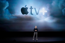 Apple CEO Tim Cook speaks at the Steve Jobs Theater during an event to announce new products, in Cup...