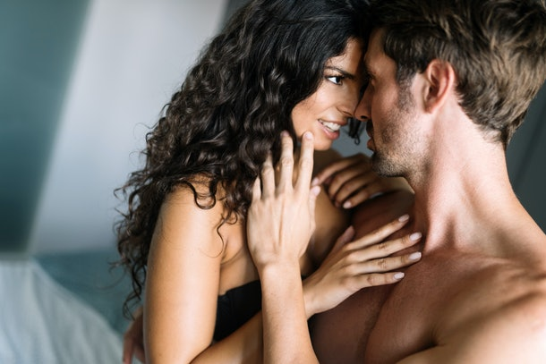 Sensual beautiful couple in loving relationship during sexual foreplay