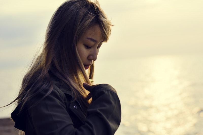 Woman alone on the sunrise beach
