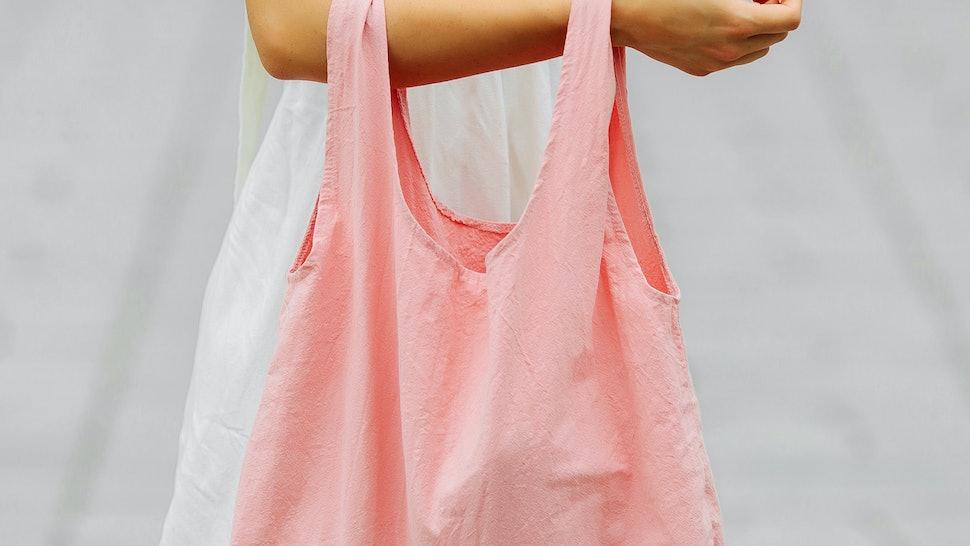 Woman holding cotton eco bag. Reusable eco bag for shopping. Zero waste concept. Mock up
