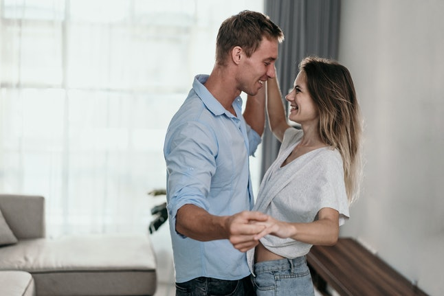 Intimate couple dancing at home. romance and love