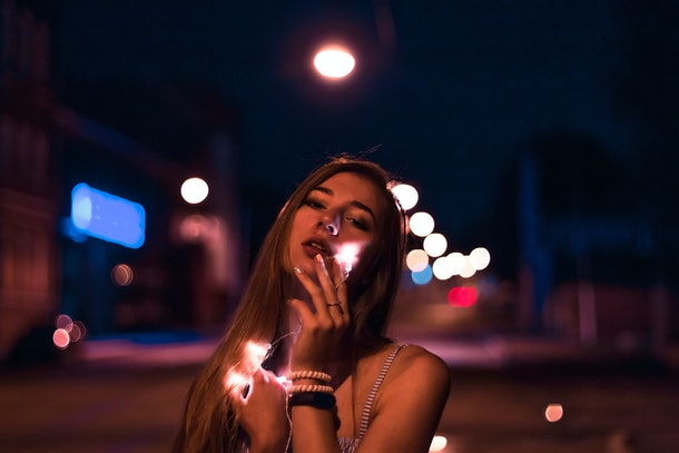 beautiful girl on the night street of the city