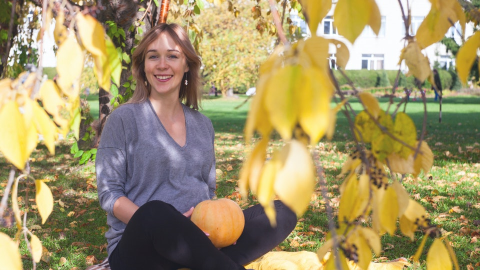 Pregnant caucasian woman takes rest outdoor, funny smiling portrait