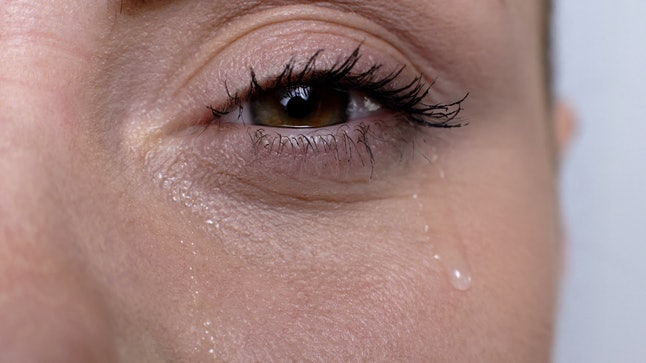 Woman crying suffering seasonal allergies, lacrimation, bad cosmetics quality