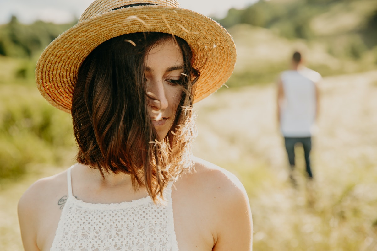 Frustrated young woman looking in distance, think about relationships, staying separately with man, ...