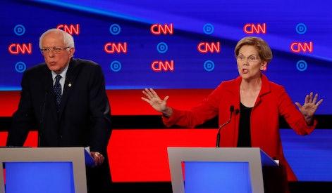 Sen. Bernie Sanders, I-Vt., and Sen. Elizabeth Warren, D-Mass., participate in the first of two Demo...
