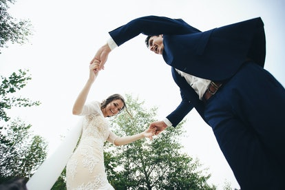 beautiful and happy groom and bride having fun outdoors