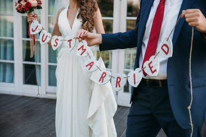 Beautiful wedding inscription just married. Close-up beauty placard. Bridal and groom accessories. Details for marriage, decoration for couple