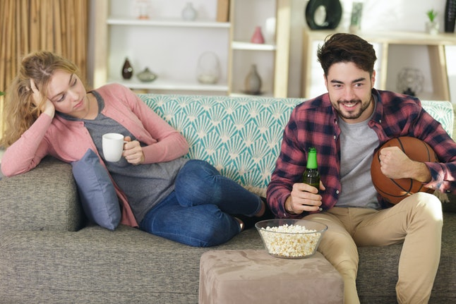woman is frustrated because her man is watching tv