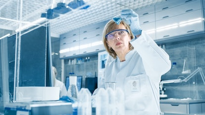 Shot of High Tech Ultra Modern Laboratory with Senior Womsn Scientists Conducting experiments and Mixing Chemicals.