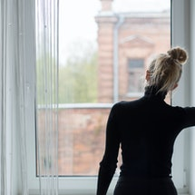 Woman waiting and looking out the window