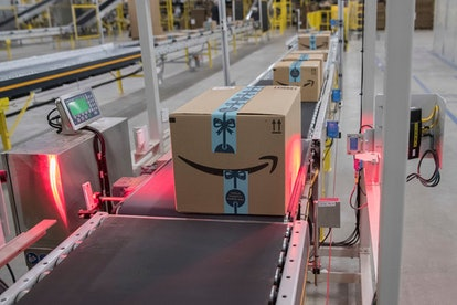 In this Dec. 5, 2018, photo a box is scanned and weighed before at the Amazon fulfillment center on ...